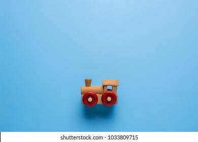 Toy train with copy space for your text on blue background