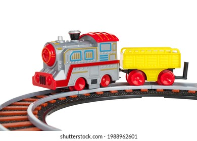 toy train with freight car trolley on railway tracks, isolated on white background, children's railway with steam locomotives, battery powered train
