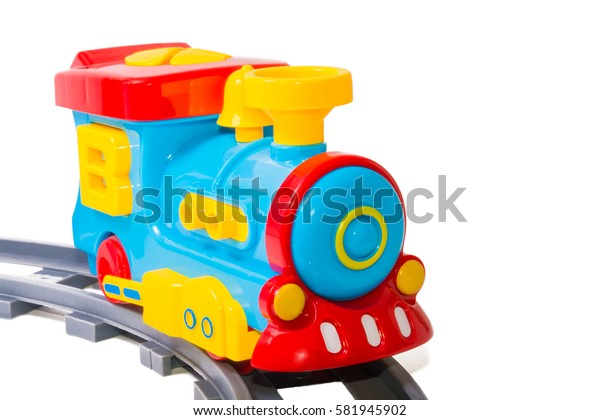 Toy train on rails. Bright colors. Railway.