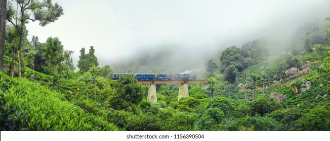 The toy train in Ooty, Tamil Nadu india running in the bridge between misty mountains in winter season