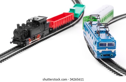 Toy trains on railroad isolated on white background