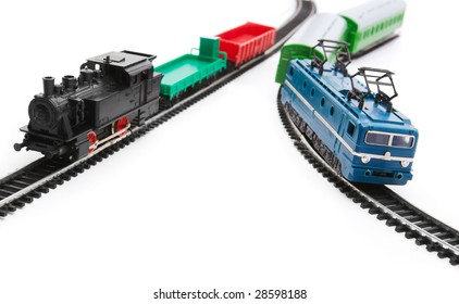 Toy trains and railroad isolated on white background
