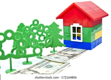 toy trees , monetary alley in front of a small house