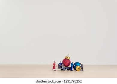 Toy truck carrying Christmas decorative balls. Christmas concept with copy space.