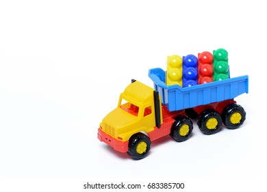 Toy truck with plastic cubes isolated on white background