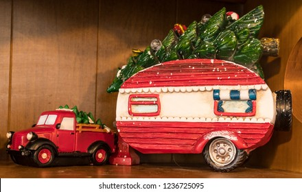 Toy Truck and Trailer painted in Red and White Christmas Colors carrying a Green Christmas Tree