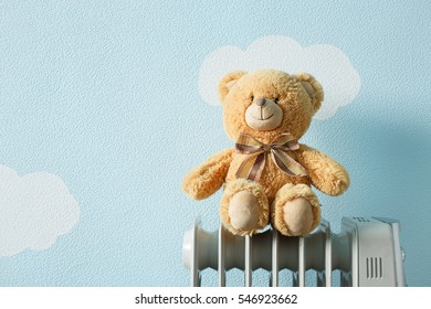 Toy warms to electric heating radiator