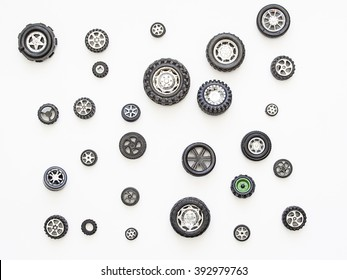 Toy wheels on a white background pattern. Top view of child's toy car wheels.