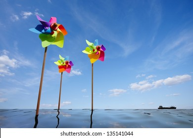 Toy windmill concept of green energy wind farm at sea