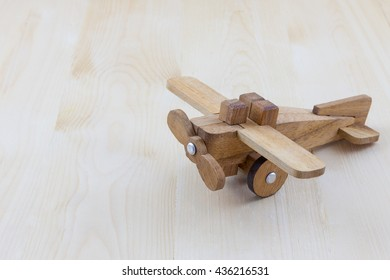 Toy wood airplane on wood background