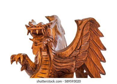 Toy wood dragon isolated on white background