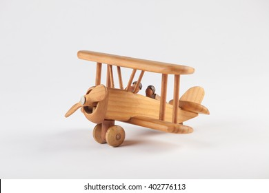 Toy wooden airplane on textured background