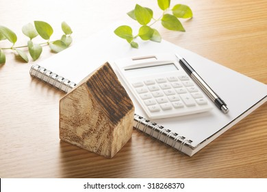 Toy wooden house and calculator