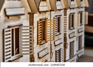 Toy wooden houses with opening and closure shutters. The constructor carved from plywood for children.