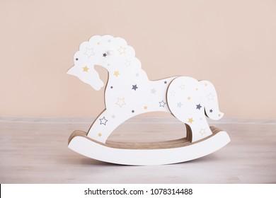 Toy wooden rocking horse. Children toy