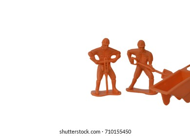 A toy worker is working on a drilling work on a white background with space for text.