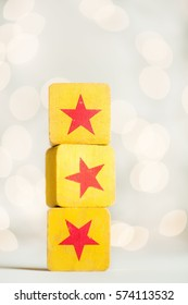 Toy yellow blocks with orange stars and lighted white background