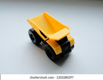 Toy yellow mining truck on a white background