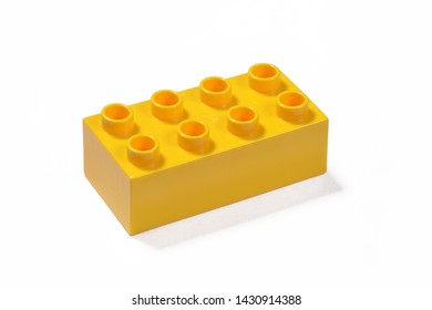 Toy yellow plastic block isolated on white background