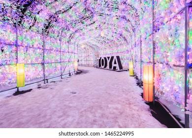 Toya Japan - January 12, 2019: Beautiful led light bulb tunnel of winter snow festival light up at dusk in Toya Lake, Hokkaido, Japan