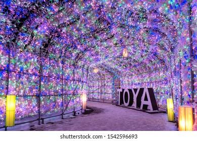 Toya Japan - January 12, 2019: Toya lake onsen Illumination tunnel snow festival event light up in winter at Toya city, Hokkaido, Japan