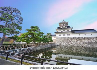 Toyama Castle and twilight time background in Toyama City, Japan.