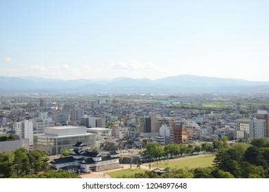 TOYAMA, JAPAN - MAY 14,2015: The city landscape of Toyama with Tateyama snow mountain background, Toyama