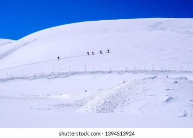 Toyama, Japan-April 18, 2019 : Japan Alps tateyama korobe  alpine route with the height  snow wall and surrounding with snow mountain.