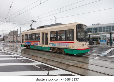 """TOYAMA,JAPAN-APRIL 6,2015 : The 7000 Series """"Centram"""" of Toyama city tram. This Tram-train operated by Toyama Chiho railway. This tram travels in a loop around Toyama central district."""