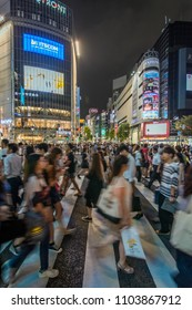 Toyko / Japan - 08.17.2017: People walking in the Shibuya during night.