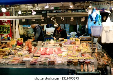 TOYKO, JAPAN - DECEMBER 05, 2016: Unidentified Japanese fish market clerk preparing the fish for the clients in Tsukiji fish market in Toyko, Japan