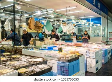 TOYOSU TOKYO, JAPAN - FEB 23 Merchants sale seafood in Toyosu fish market on FEB 23, 2019 in Toyosu Tokyo, Japan. Toyosu Market is new wholesale market that replaces the historic Tsukiji fish market.