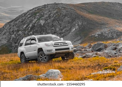 Toyota 4runner in mountains. Summer off road trip travel. Rural scenery. Car tourism. 4x4 off-road suv car. Almaty, Kazakhstan, 31 AUGUST 2019