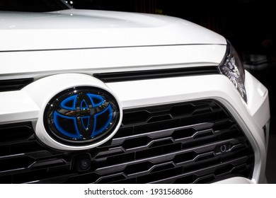 Toyota RAV4 hybrid car headlight close up at the Paris Motor Show. France - October 3, 2018