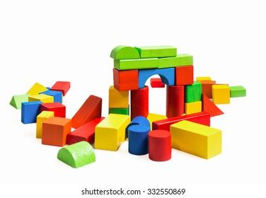 Toys blocks multicolor wooden bricks on white background