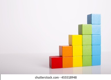 Toys Blocks Step Stair, building bricks over white color background, multi color wooden ladder