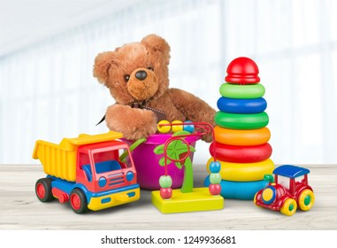 Toys collection in box isolated on white background. Donatation. Copy space for text