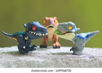 Toys mini figure dinosaurs playing