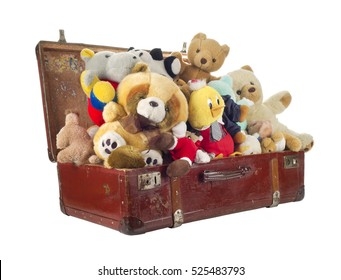 Toys in old suitcase, isolated on white background