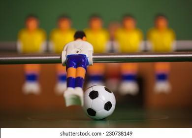 Toys players. foosball. soccer ball