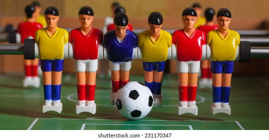 Toys players. foosball. soccer ball