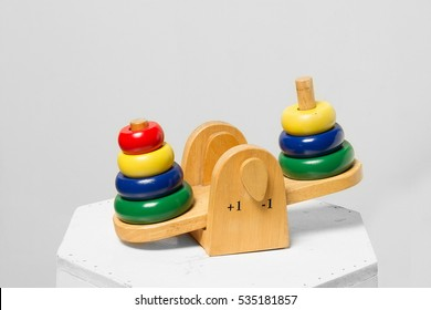 Toys seesaw wooden on grey background