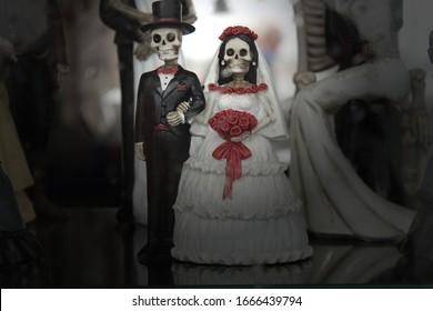 Toys skeletons of the bride and groom. Skeleton wedding. Love concept. Love till death.