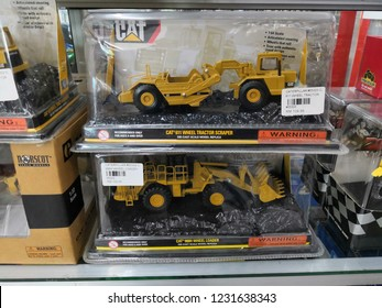 Toyshop, Kapar, Selangor, Malaysia - November 2018: Tractor Scrapper toys for kids display for sale in the toy store. Located in Kapar, Selangor Malaysia.