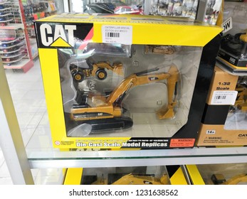 Toyshop, Kapar, Selangor, Malaysia - November 2018: Hydraulic Excavator toys for kids display for sale in the toy store. Located in Kapar, Selangor Malaysia.