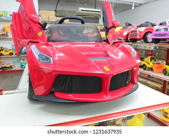 Toyshop, Selangor, Malaysia - November 2018: Closeup Ferrari Kids Electric Ride for children display for sale in toy store.Ferrari is an Italian luxury sports car manufacturer based in Maranello