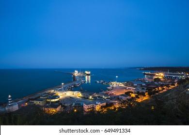 The Trabocchi coast. Night landscape of Ortona harbor in Abruzzo, Italy