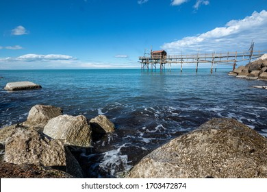 the Trabocco or trabucco (fish-trap) on the beach of Termoli, is an ancient fishing machinery on wooden pilework with long arms that support a large net, typical of Adriatic Sea. Termoli, Molise Italy