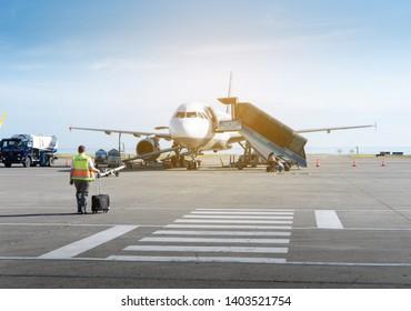 Trabzon, Turkey - May 23, 2018 : The aircraft maintenance staff walking to the plane to do his job