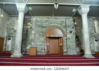 Trabzon, Turkey - September 6, 2018. Interior view of Aya Sofya mosque in Trabzon, Turkey, with two columns, furniture and Arabic inscriptions.